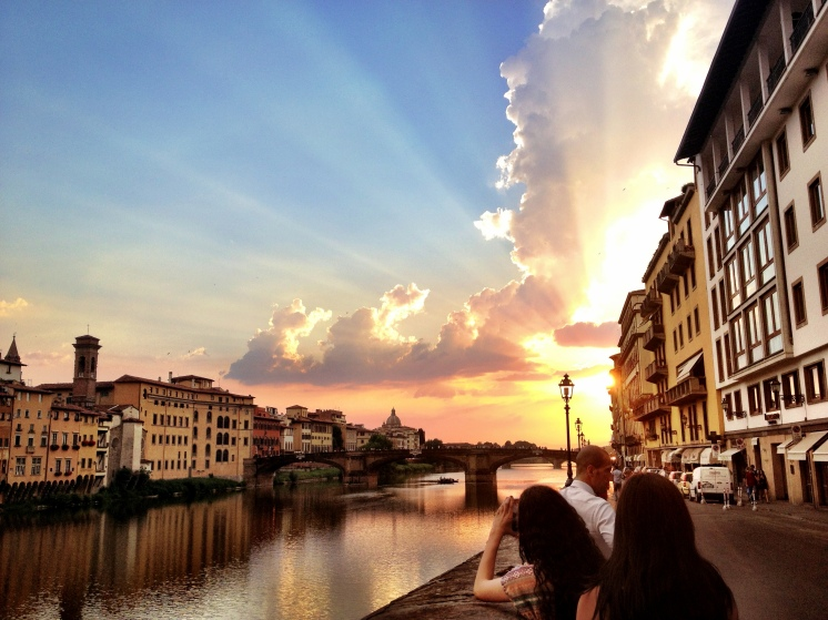 A scene of Florence in the sunset glow after the rain