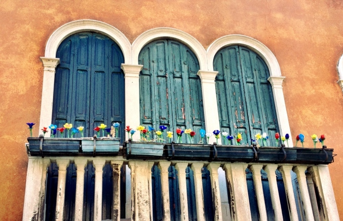 A window decorated with flowers made of Murano